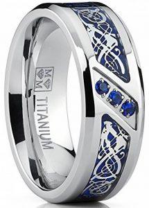 Ultimate Metals Co.® Bague de mariage en Titane avec dragon désign en fibre de carbone bleu et zircone cubique bleu. Pour Homme de la marque Ultimate Metals Co. image 0 produit